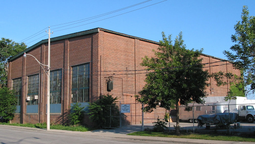 The front of the brown Foundry building on a clear, blue day.