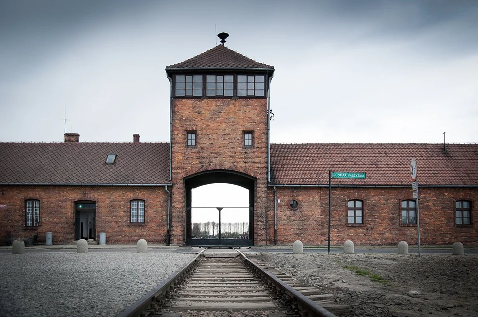 a railroad track leads to the inside of a door to the Auschwitz concentration camp