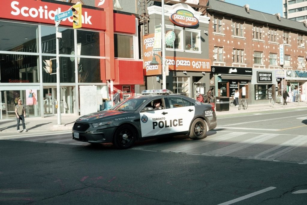 a Toronto police vehicle on the streets in front of shops downtown like PizzaPizza and Scotiabank