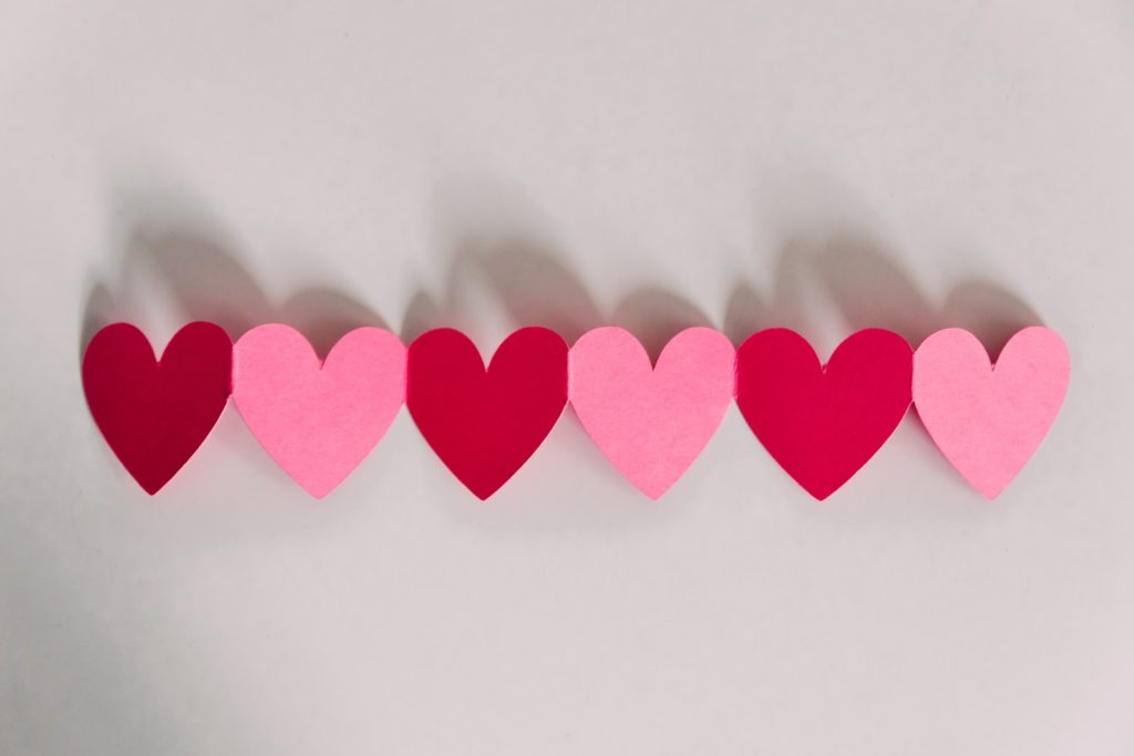 six pink and red hearts displayed by alternating colours on a white background