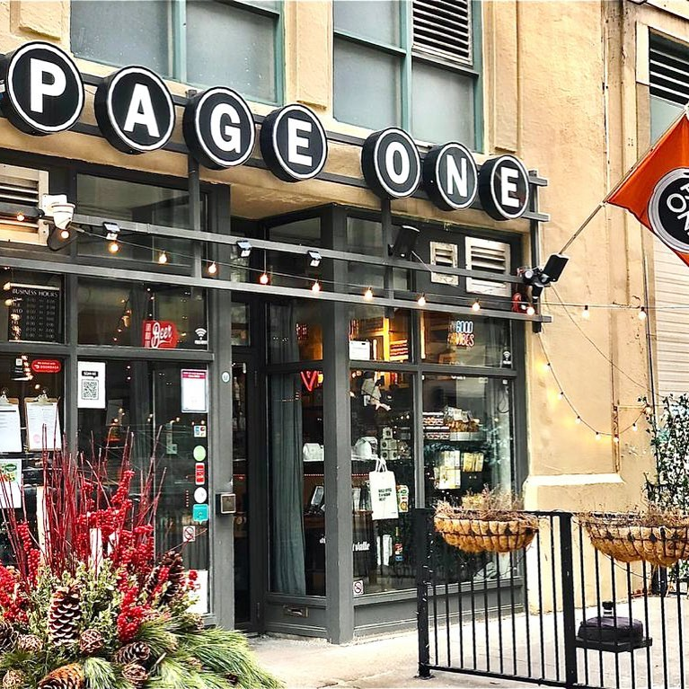 the storefront of the Page One Cafe across from Ryerson University with the business's name written on singular circular boards