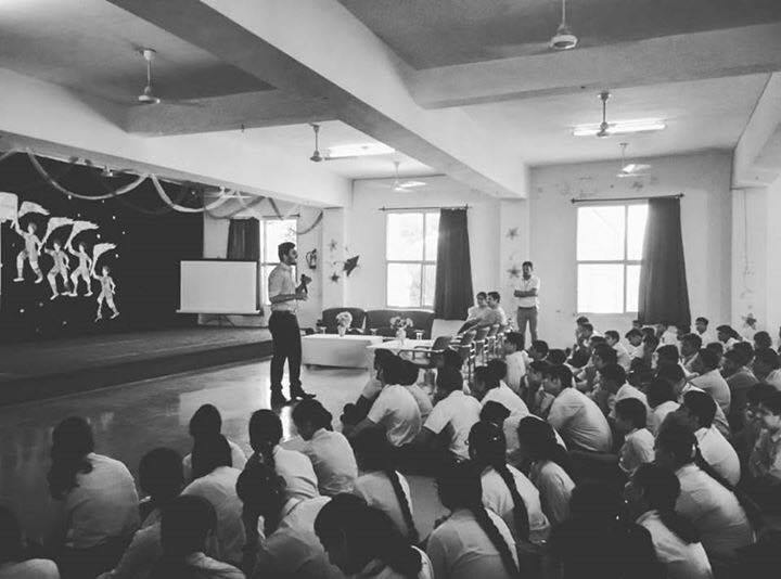 Speaking to a group of students at a high school in India telling my story (Abhi Raheja)
