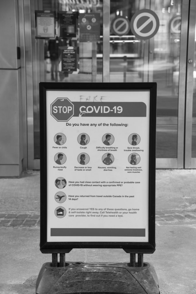 a public health sign that has advice on how to stop the spread of COVID-19 like wearing a mask over our noses and mouths, washing hands and staying at home if ill