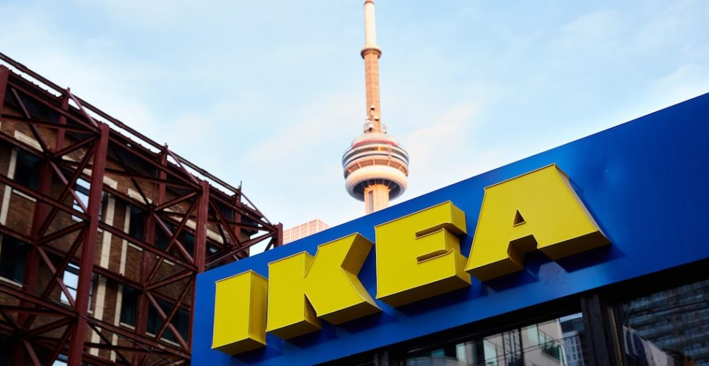 the IKEA sign in the foreground with the CN tower behind it