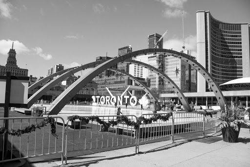 a view of the arches over Toronto's skating rink at nathan phillips square