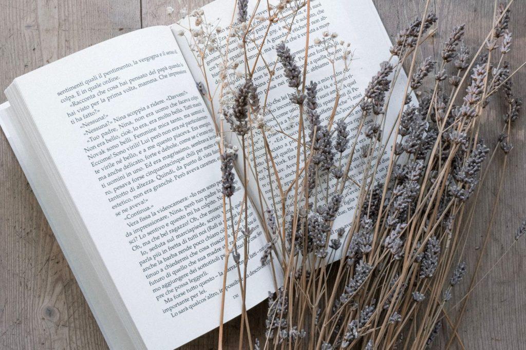 a book on a wooden porch
