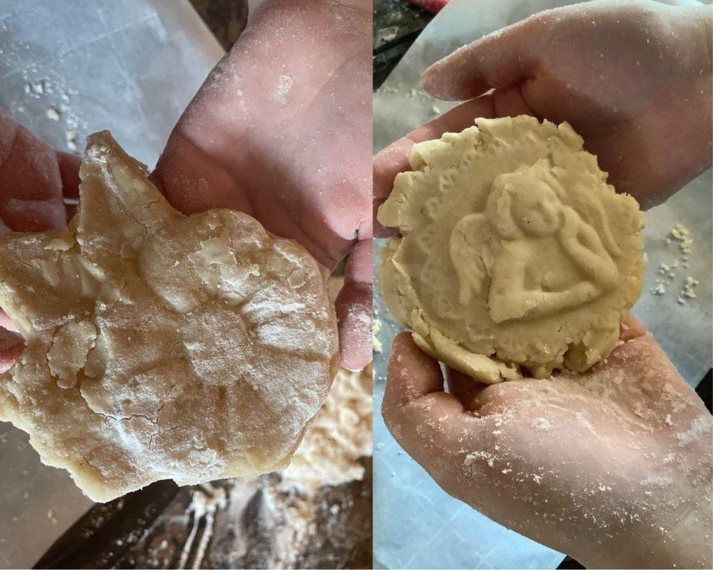 a close up shot of hands kneading dough