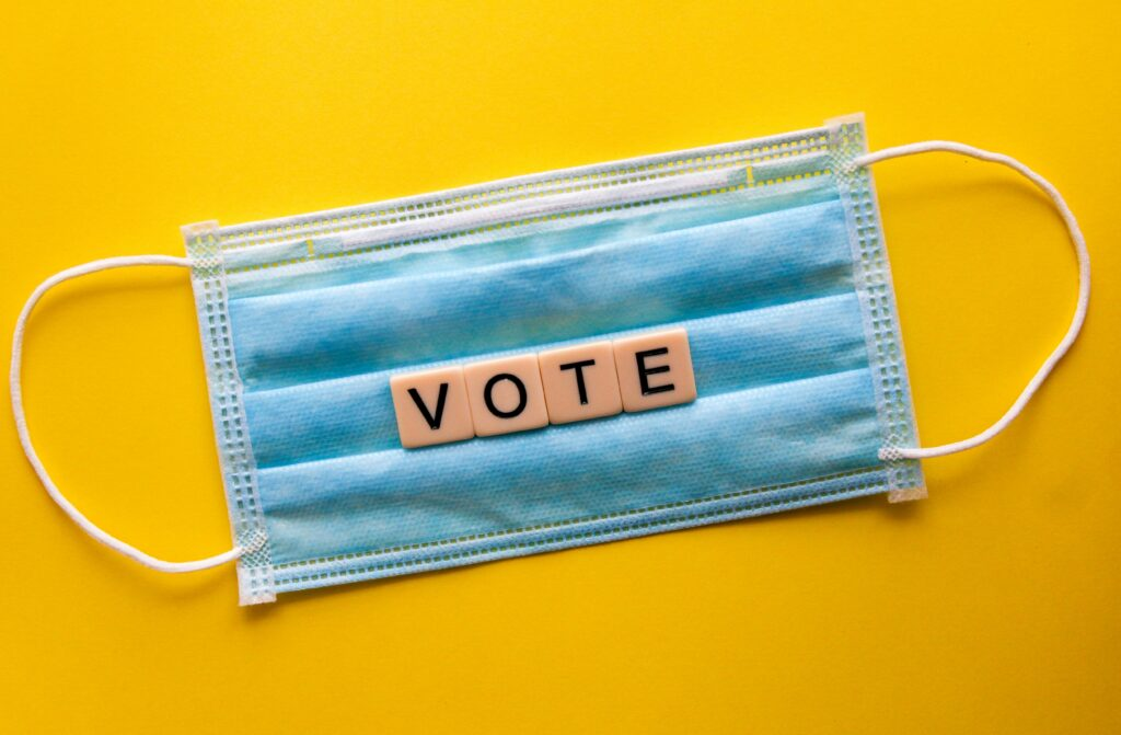 Face mask with VOTE printed on it