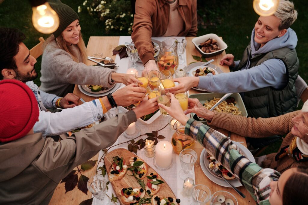 People toasting around a Thanksgiving spread