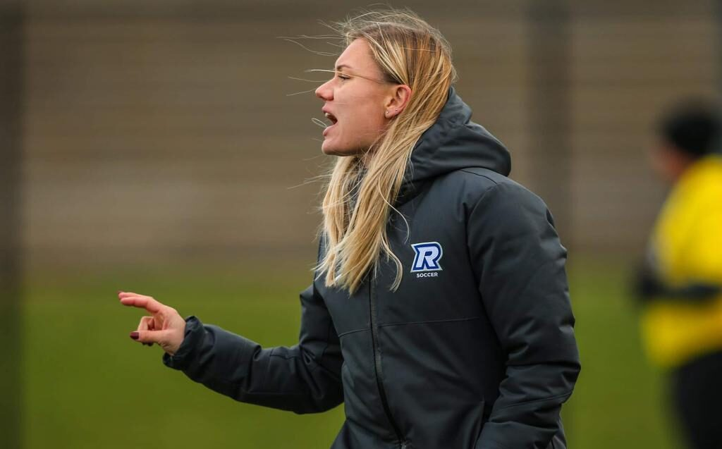 Soccer coach on sidelines